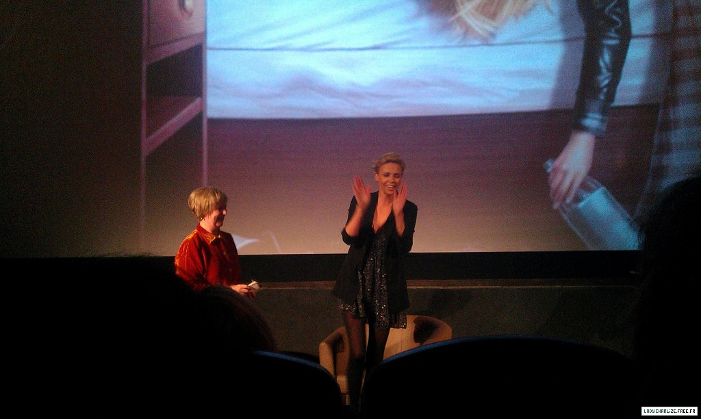 Charlize in a barely there dress at the screening of young adult in London